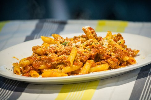 Penne Boscaiola: chicken, bacon, onion, mushrooms, peas in a creamy sauce Served with parmesan cheese