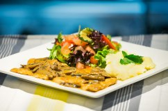 Chicken Scaloppine: chicken breast with a creamy mushroom sauce served with mashed potato and salad