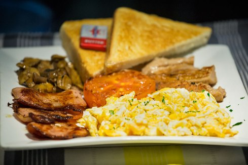 Big Breakfast: scrambled eggs, bacon, mushrooms, tomato, Sausage and toast