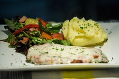 Parmigiana: chicken schnitzel topped with napoletana sauce and melted cheese. Served with mashed potato and salad