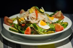 Tuna Salad: tuna, lettuce, tomato, onion, capsicum, zucchini, eggplant and boiled egg served with balsamic and olive oil dressing